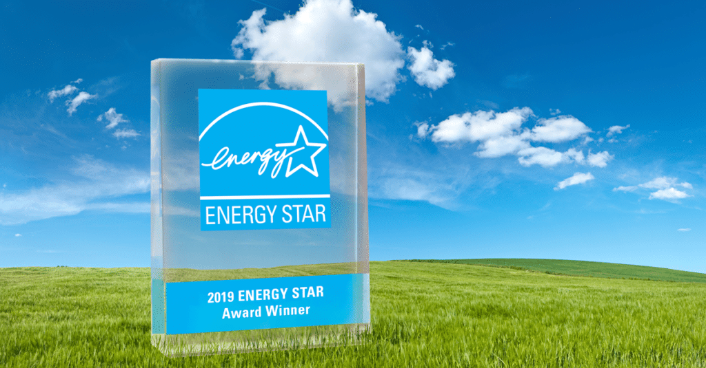 Energy Star award on green grass with bright clouds