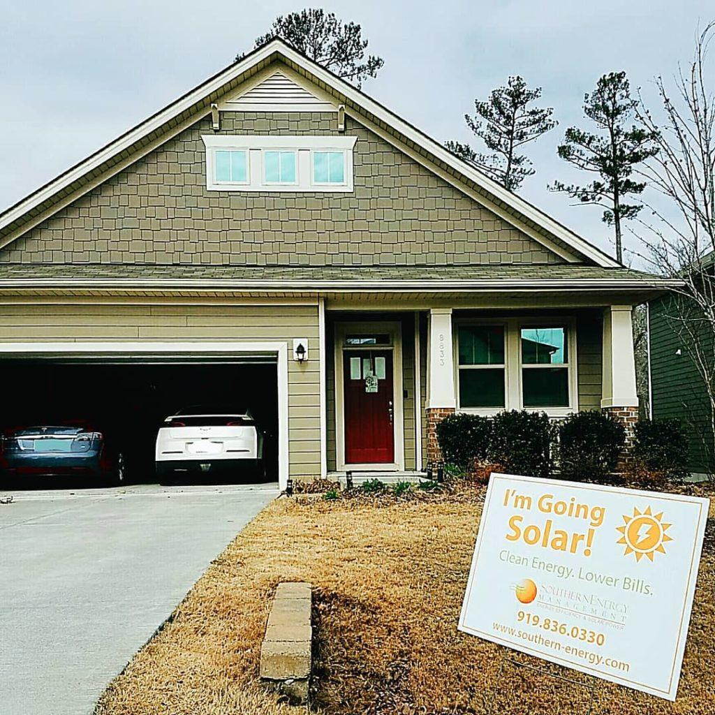 "Home of an SEM customer with ""I'm Going Solar"" sign"