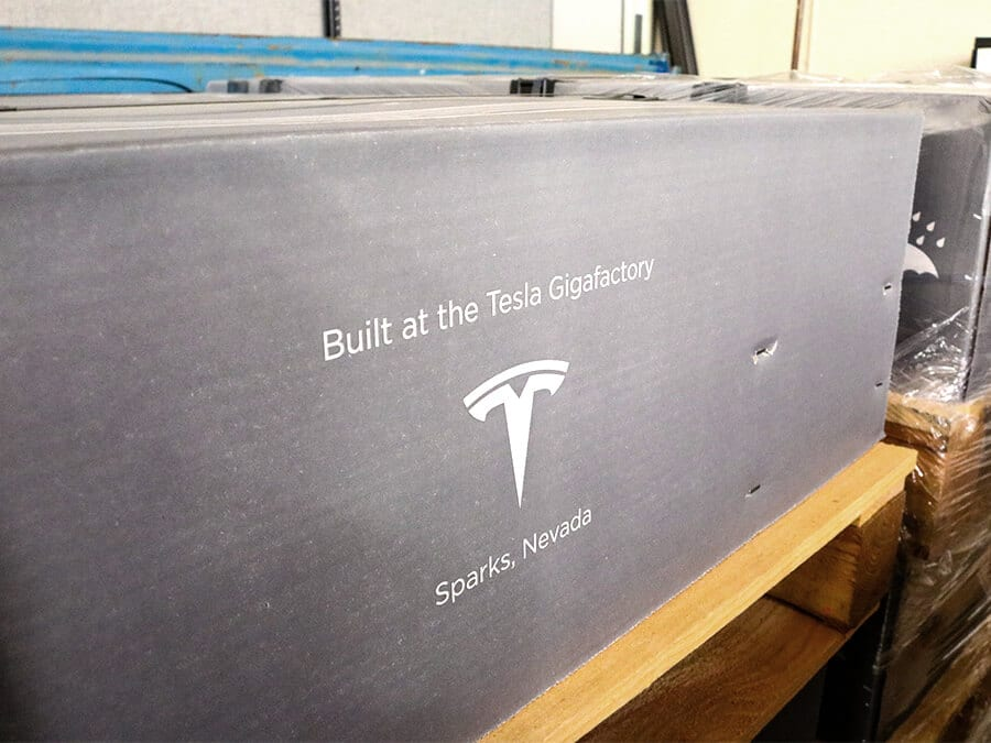 "Powerwall in box that says ""Build at the Tesla Gigafactory, -- Sparks, Nevada"""