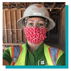 Rachel, Project Manager at Southern Energy Management, at construction site wearing ppe and mask