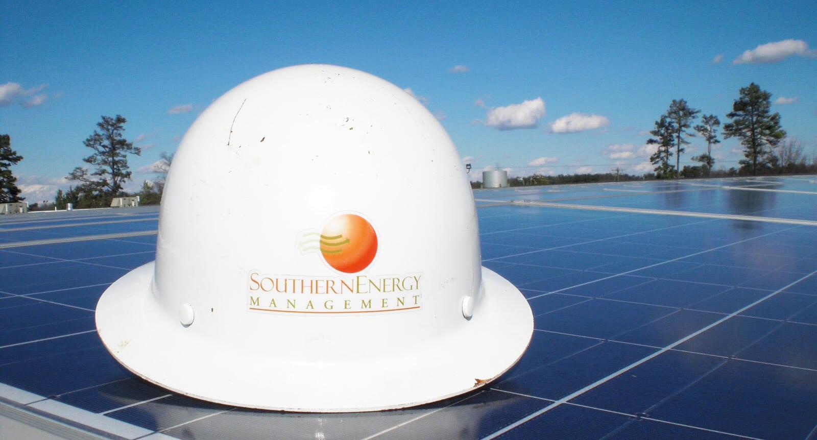 Southern Energy Management hardhat on solar panel