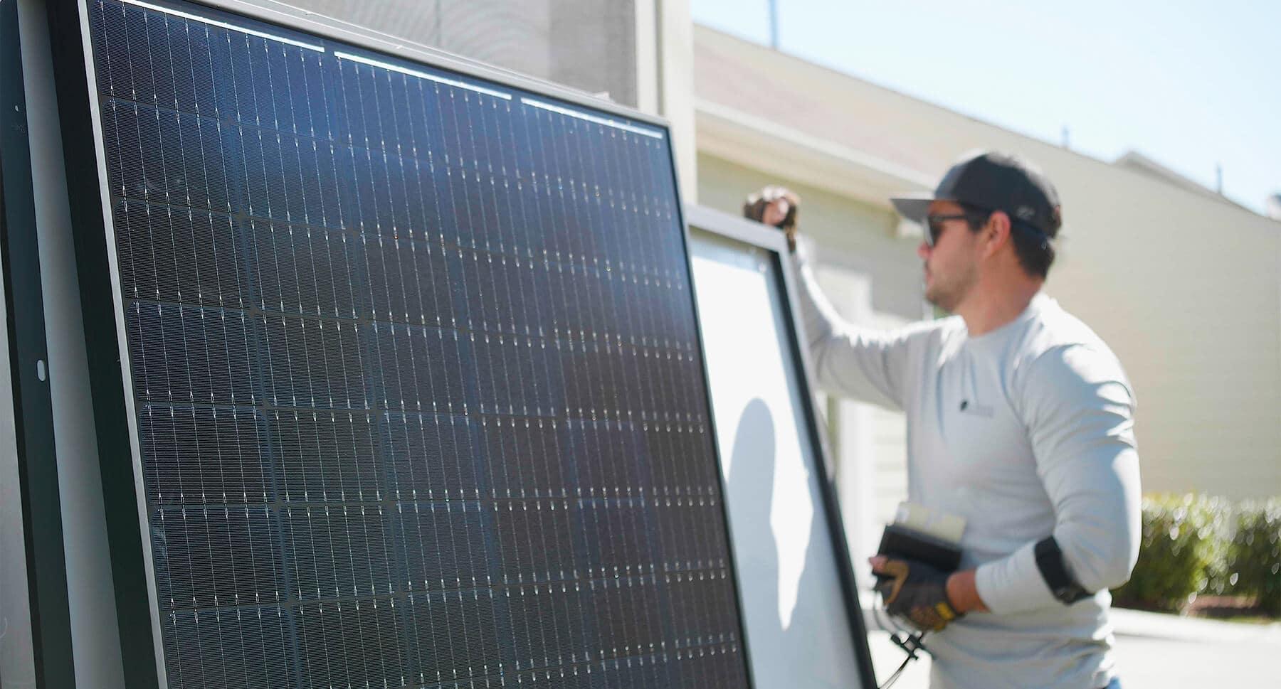 Solar Installer Inspecting Panels
