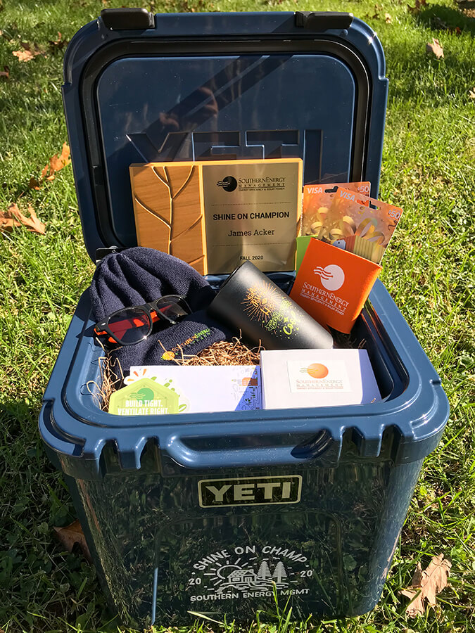 Navy blue Yeti cooler filled with a variety of prizes and the Southern Energy Management shine on champion award