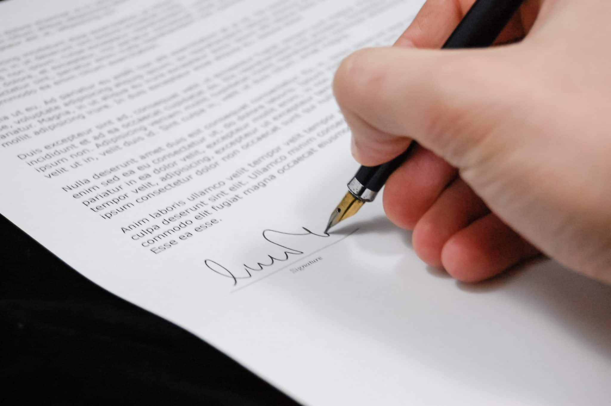 Signing a contract on a home sold at a price premium.