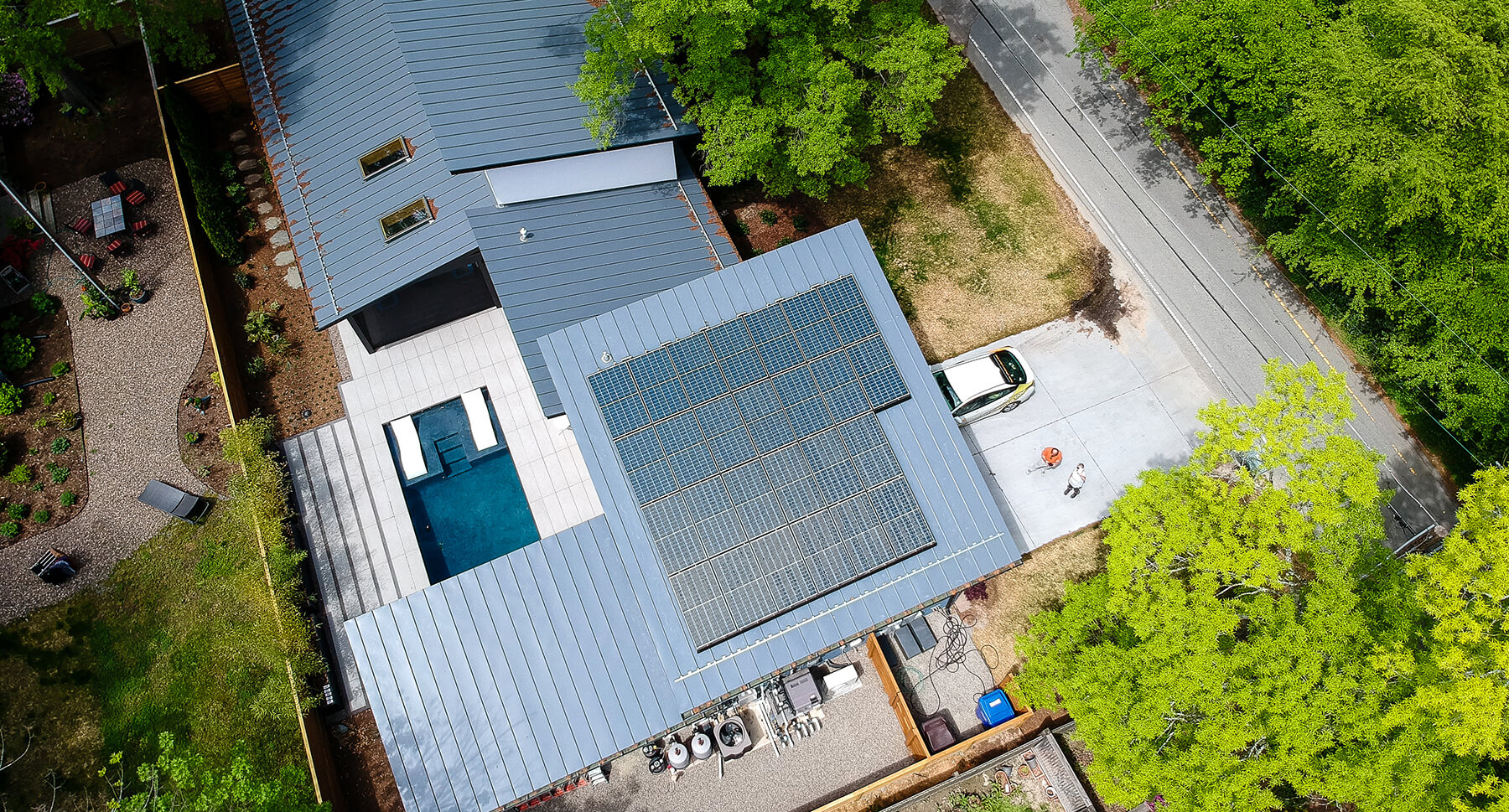 Aerial view of a blue metal roof with poly solar system installed