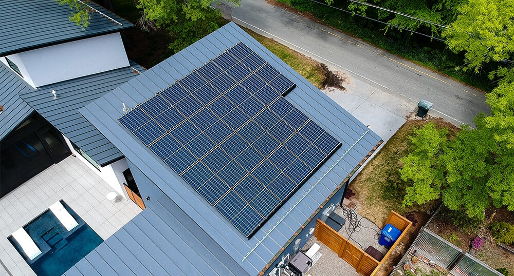 Poly panel solar system installed on a blue metal roof