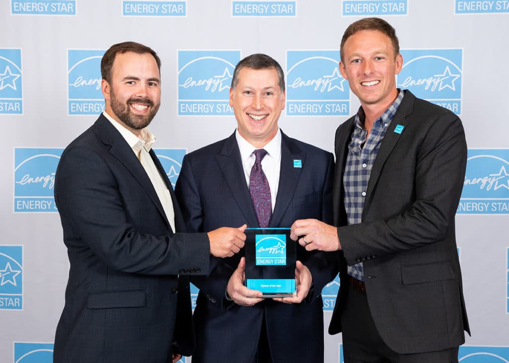 Taylor and Daniel accepting the 2019 Energy Star Partner of the Year Award