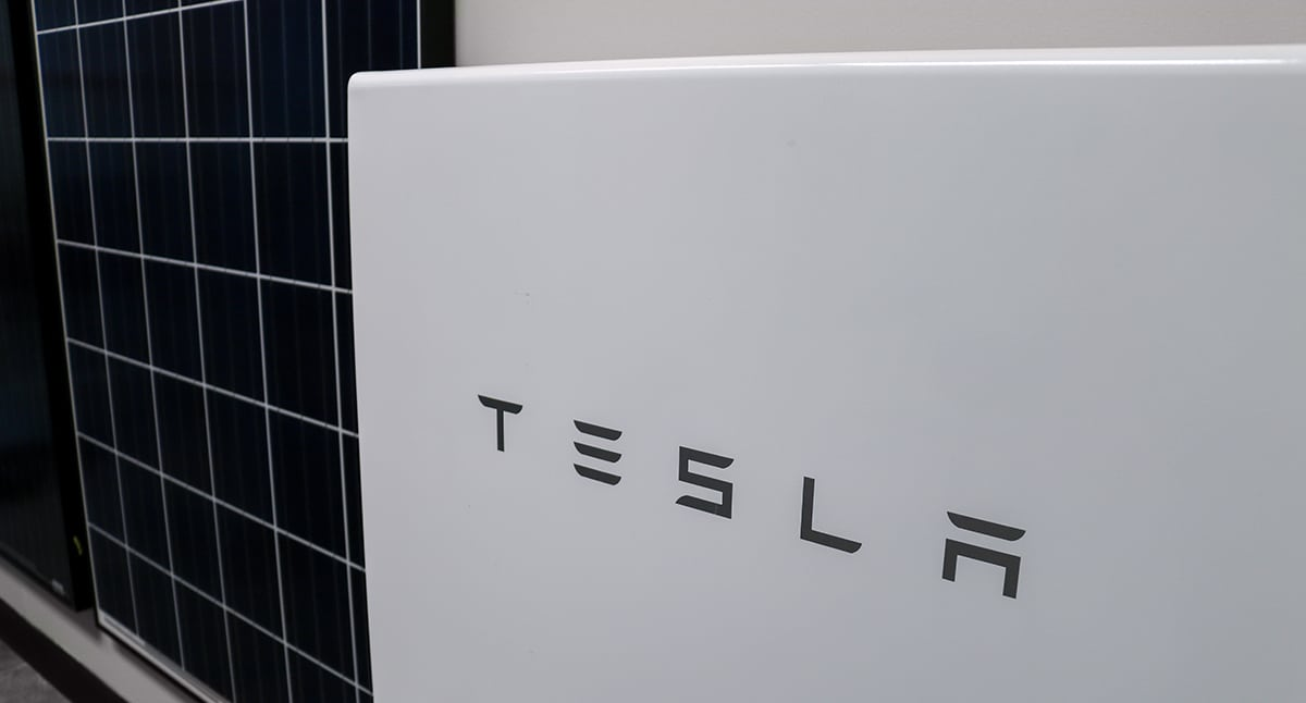 Tesla Powerwall next to poly solar pv panel