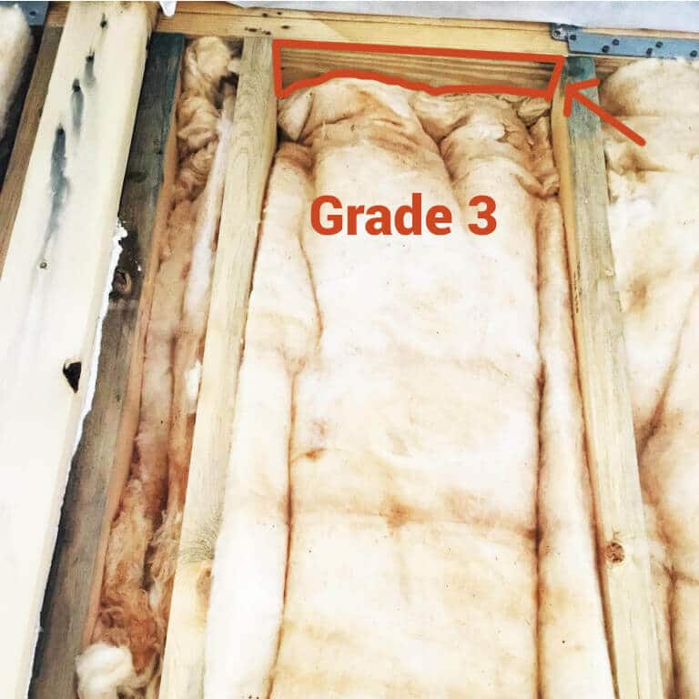 Batt is not cut to cavity size and is squeezed in as seen by the exposed wood above.
