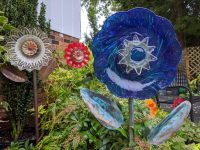Glass flowers in a garden made by local Durham Artist
