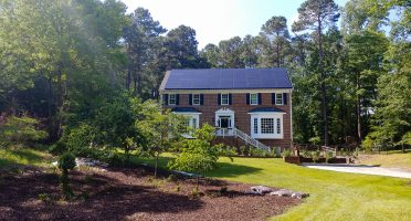Brick home with solar system on the roof