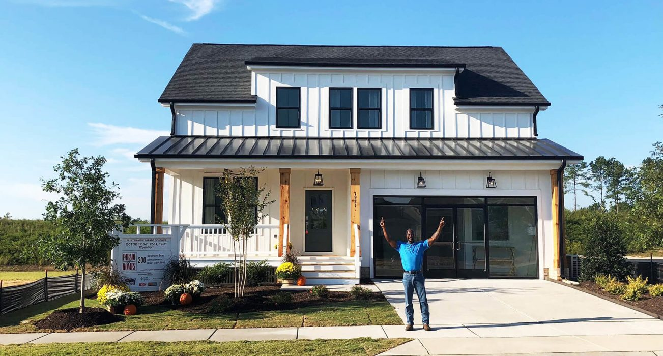 Shine On Champ, Robert Thornton in front of the newly completed Garman Model Home at Wendell Falls