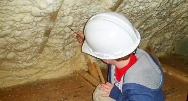 Child inspecting spray foam levels in an attic
