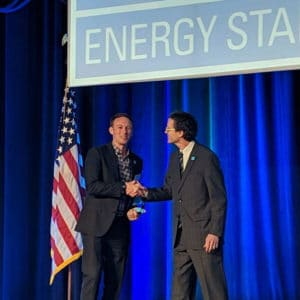 Taylor accepting the Energy Star Partner of the Year Award on stage