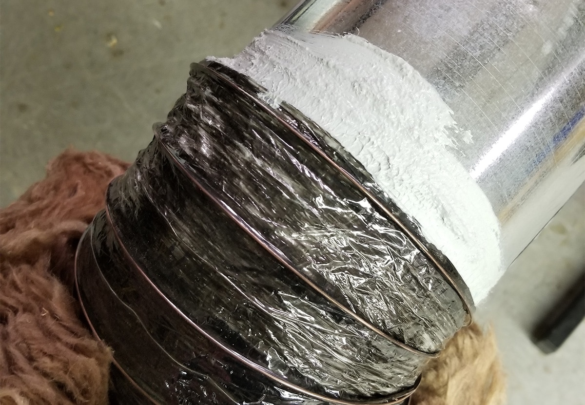 Flex duct collar secured with mastic