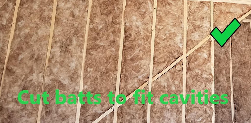 Insulation installed correctly with batts cut to fit cavities