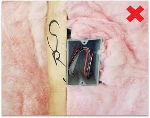 Poorly installed insulation compressed around receptacle
