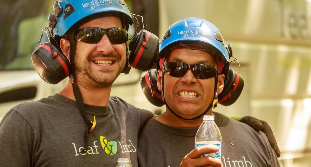 Two team members from Leaf & Limb with their tree care gear on