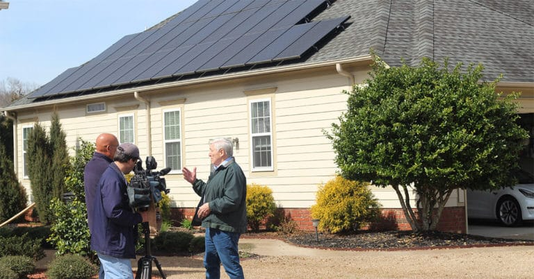 home solar panel owner being interview by WRAL