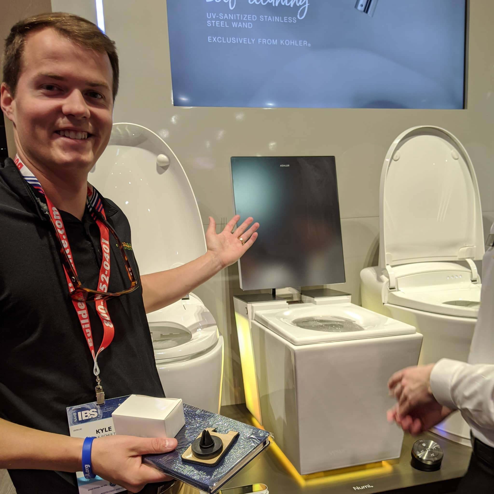 Kyle showing off the Numi throne at IBS 2020