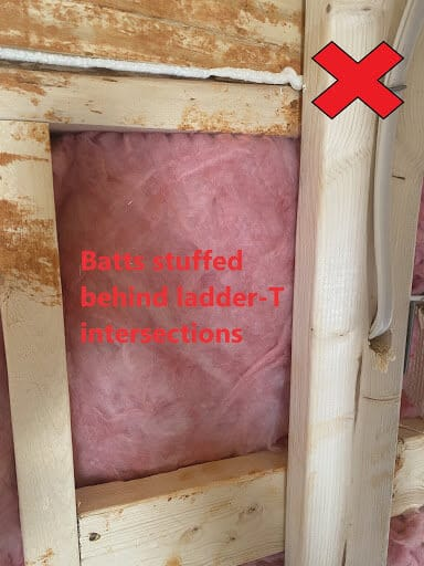 Insulation installed improperly with batts stuffed behind ladder T intersections