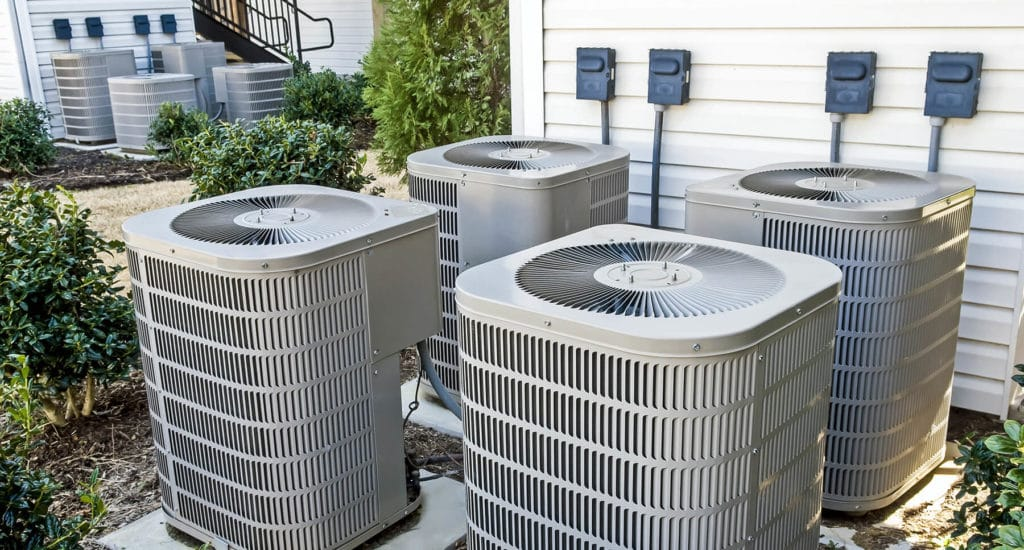HVAC units outside of a multifamily apartment building