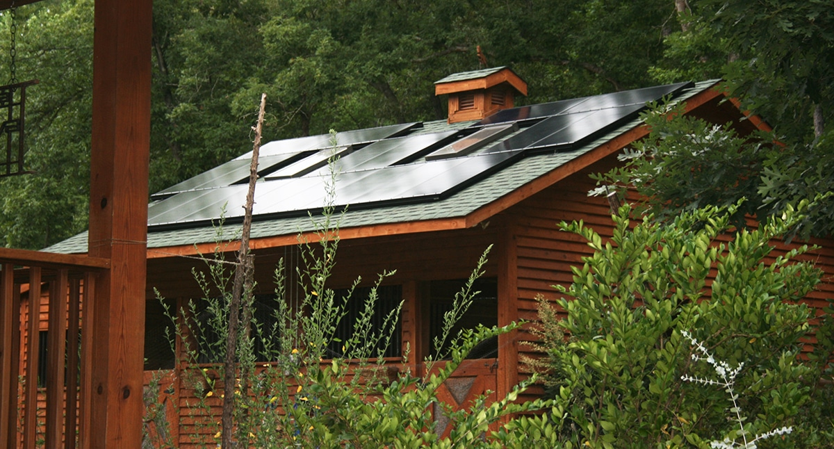 Solar on a natural wood barn in the forrest