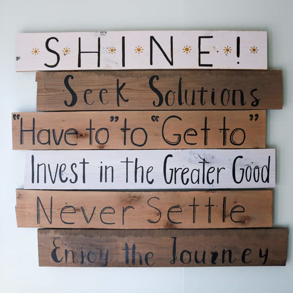 Wood plank sign of SEM's core SHINE values