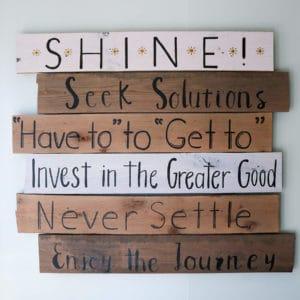 Wood plank sign of SEM's core SHINE values