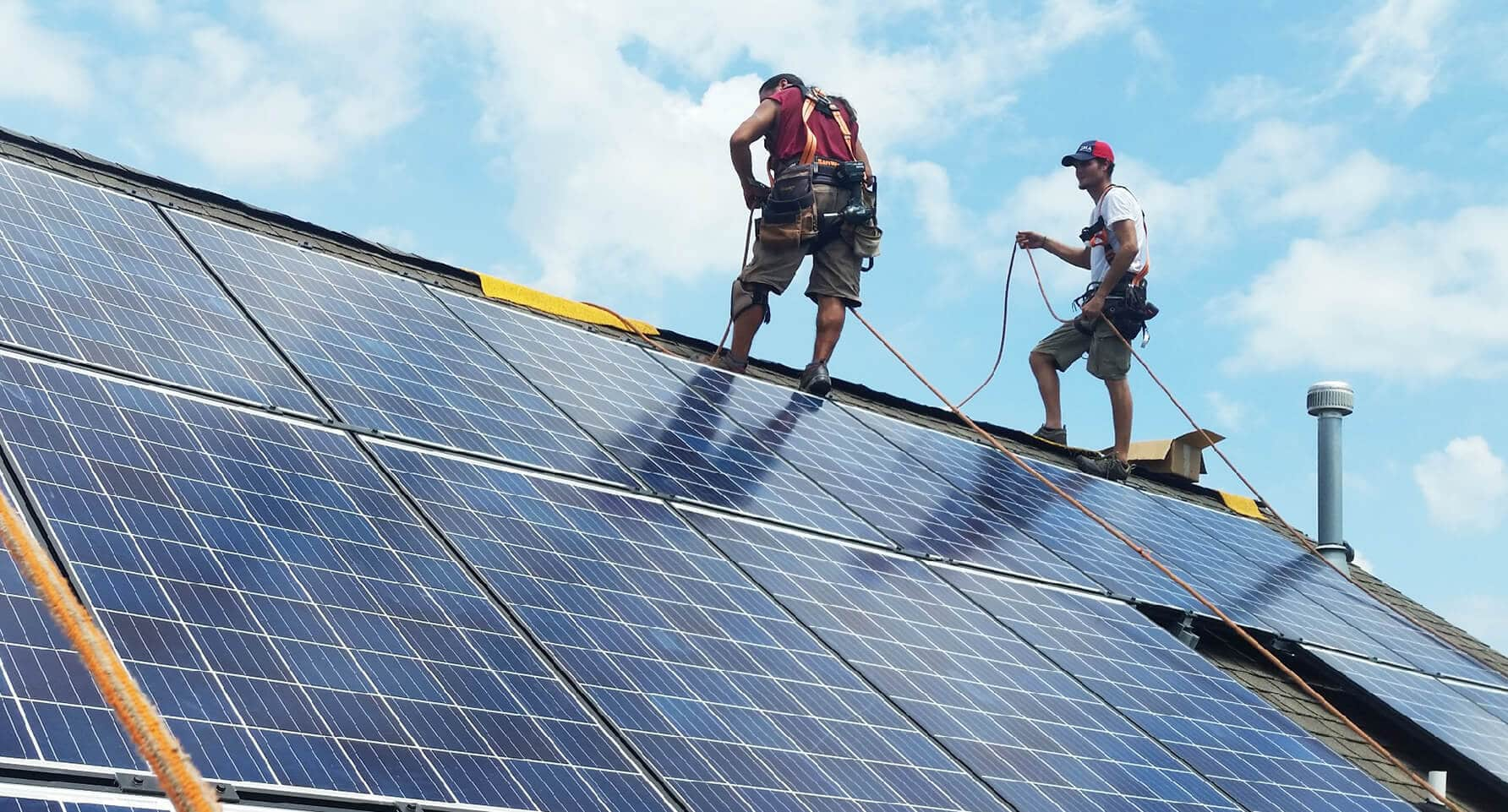 Solar Installers on a Rooftop Installation