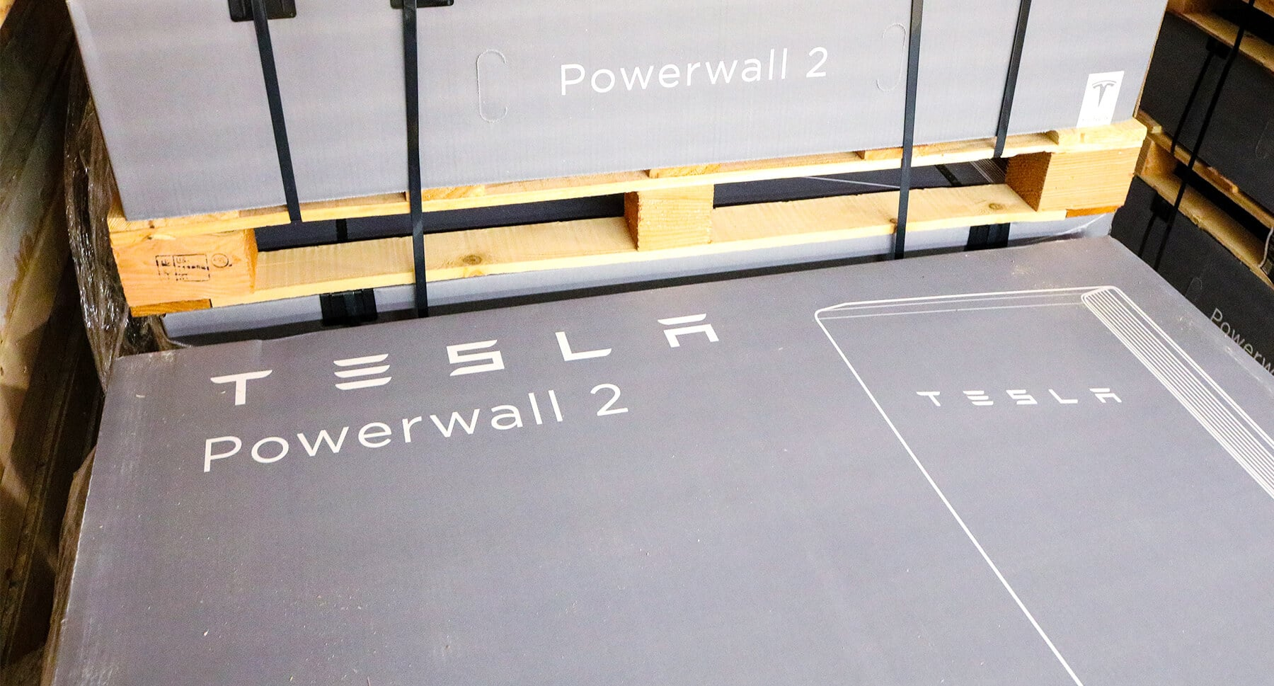 Tesla Powerwall 2 in gray box