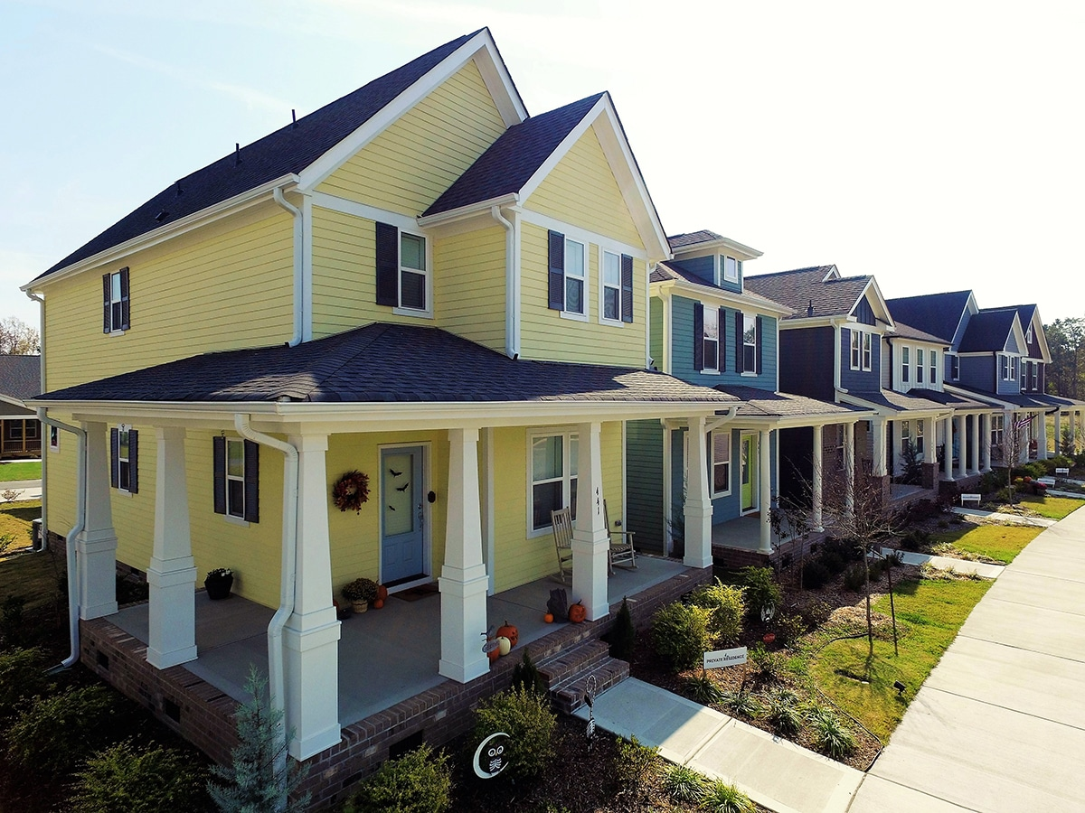 Row of colorful net-zero homes in Wendell Falls